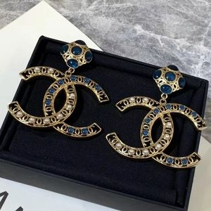Chanel Coco  Gold Color Earrings  with Blue stones
